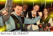 Купить «males and females in business suits posing at laser tag room», фото № 32154617, снято 4 апреля 2019 г. (c) Яков Филимонов / Фотобанк Лори