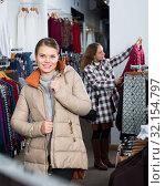 Купить «Woman standing in overcoat in boutique», фото № 32154797, снято 6 декабря 2018 г. (c) Яков Филимонов / Фотобанк Лори