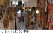 Купить «Young female tourist walking along old town market», видеоролик № 32155409, снято 14 июня 2017 г. (c) Vasily Alexandrovich Gronskiy / Фотобанк Лори