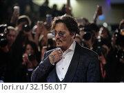 Купить «Johnny Depp during Waiting For The Barbarians red carpet. 76th International Film Festival, Venice, Italy 06-09-2019.», фото № 32156017, снято 6 сентября 2019 г. (c) age Fotostock / Фотобанк Лори