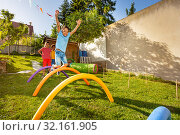 Купить «Race game with obstacles kids jump over barrier», фото № 32161905, снято 29 июня 2019 г. (c) Сергей Новиков / Фотобанк Лори
