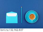 Купить «Blue paper letter envelope and coffee cup», фото № 32162837, снято 26 марта 2019 г. (c) Anton Eine / Фотобанк Лори