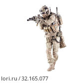 Купить «Army infantryman in camouflage uniform, battle helmet, tactical radio headset, extra ammo on load carrier, sneaking, aiming with laser sight on assault rifle studio shoot isolated on white background.», фото № 32165077, снято 9 декабря 2017 г. (c) easy Fotostock / Фотобанк Лори