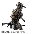 Купить «Army Ranger in field Uniforms with weapon, plate carrier and combat helmet are on, his face closed by Shemagh Kufiya scarf. Studio shot.», фото № 32165445, снято 8 апреля 2020 г. (c) easy Fotostock / Фотобанк Лори