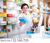 Купить «Pharmacist ready to assist in choosing at counter», фото № 32166729, снято 31 января 2017 г. (c) Яков Филимонов / Фотобанк Лори
