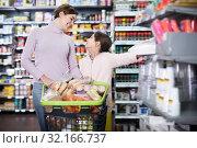 Купить «Woman and girl with shopping cart», фото № 32166737, снято 5 января 2017 г. (c) Яков Филимонов / Фотобанк Лори