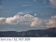 Купить «Mount Fuji summit in the clouds. Hakone area of Kanagawa Prefecture in Honshu. Japan», фото № 32167509, снято 1 декабря 2007 г. (c) Serg Zastavkin / Фотобанк Лори