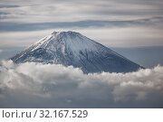 Купить «Mount Fuji summit in the clouds. Hakone area of Kanagawa Prefecture in Honshu. Japan», фото № 32167529, снято 1 декабря 2007 г. (c) Serg Zastavkin / Фотобанк Лори