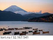 Купить «The view of Mount Fuji summit at the sunset over the Lake Ashi. Kanagawa Prefecture. Honshu. Japan», фото № 32167541, снято 1 декабря 2007 г. (c) Serg Zastavkin / Фотобанк Лори