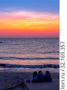Купить «Three women waiting for the sunrise in front of the sea (Puglia region, South of Italy). Concept of frienship, travel and adventure.», фото № 32169357, снято 4 апреля 2020 г. (c) easy Fotostock / Фотобанк Лори