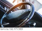 Купить «car steering wheel with shallow depth of field», фото № 32171593, снято 11 сентября 2019 г. (c) Дмитрий Бачтуб / Фотобанк Лори