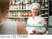 Купить «Satisfied mature woman in white robe buying different nuts in supermarket», фото № 32173881, снято 29 января 2016 г. (c) Татьяна Яцевич / Фотобанк Лори