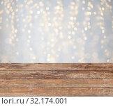 Купить «empty wooden table with christmas golden lights», фото № 32174001, снято 14 февраля 2014 г. (c) Syda Productions / Фотобанк Лори