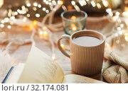 Купить «book and cup of coffee or hot chocolate on table», фото № 32174081, снято 15 ноября 2017 г. (c) Syda Productions / Фотобанк Лори