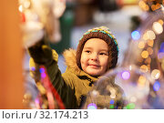 Купить «happy little boy at christmas market in winter», фото № 32174213, снято 4 января 2019 г. (c) Syda Productions / Фотобанк Лори