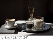 Купить «coffee, candles and aroma reed diffuser on table», фото № 32174241, снято 11 апреля 2019 г. (c) Syda Productions / Фотобанк Лори