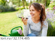 Купить «gardener recording voice message by smartphone», фото № 32174485, снято 12 июля 2019 г. (c) Syda Productions / Фотобанк Лори