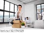 Купить «happy businesswoman with personal stuff at office», фото № 32174529, снято 23 марта 2019 г. (c) Syda Productions / Фотобанк Лори