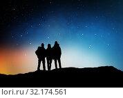 Купить «travelers or friends on edge over night sky», фото № 32174561, снято 31 августа 2014 г. (c) Syda Productions / Фотобанк Лори