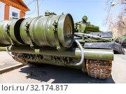 Купить «Russian army main battle tank T-72B3M in green colors at the city street», фото № 32174817, снято 5 мая 2018 г. (c) FotograFF / Фотобанк Лори