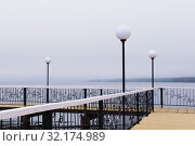 Купить «Foggy pier with lanterns», фото № 32174989, снято 9 сентября 2019 г. (c) Евгений Харитонов / Фотобанк Лори