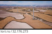 Купить «Aerial view of wind power plants near the town of La Muela, Spain», видеоролик № 32176273, снято 15 сентября 2019 г. (c) Яков Филимонов / Фотобанк Лори
