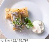Купить «Sweet Stuffed Pancakes with a Sour Cream», фото № 32176797, снято 10 июля 2019 г. (c) Володина Ольга / Фотобанк Лори