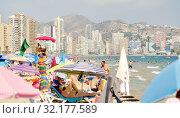 Купить «Lot of tourists on the beach of Benidorm, Costa Blanca, Spain», фото № 32177589, снято 26 июля 2019 г. (c) Alexander Tihonovs / Фотобанк Лори