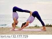 Купить «Women do yoga performing Downward Facing Dog Adho Mukha Shvanasana», фото № 32177729, снято 9 июня 2019 г. (c) Alexander Tihonovs / Фотобанк Лори