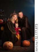 Купить «happy family mother father and baby in costumes on celebration of Halloween», фото № 32177873, снято 9 сентября 2019 г. (c) Майя Крученкова / Фотобанк Лори