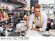 Dressmaker at work – creating pattern. Стоковое фото, фотограф Яков Филимонов / Фотобанк Лори
