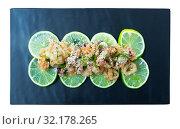 Купить «Fried calamari and sepia in a batter of tempera flour on a cushion of pickled limes», фото № 32178265, снято 17 сентября 2019 г. (c) Яков Филимонов / Фотобанк Лори