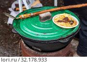 Купить «Cooking traditional Uzbek pilaf in a large cauldron», фото № 32178933, снято 10 марта 2019 г. (c) FotograFF / Фотобанк Лори