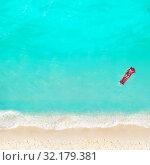Купить «Woman swim with matrass in the water on beach», фото № 32179381, снято 22 октября 2019 г. (c) Сергей Новиков / Фотобанк Лори