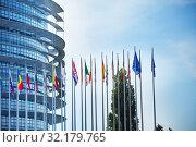 Купить «MAY 05, 2019: European Parliament with flags», фото № 32179765, снято 5 мая 2019 г. (c) Сергей Новиков / Фотобанк Лори