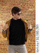 Купить «Young man wearing casual clothes», фото № 32180781, снято 23 июля 2019 г. (c) Wavebreak Media / Фотобанк Лори