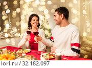 Купить «happy couple drinking red wine at christmas dinner», фото № 32182097, снято 11 января 2018 г. (c) Syda Productions / Фотобанк Лори