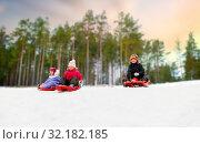 Купить «kids sliding on sleds down snow hill in winter», фото № 32182185, снято 10 февраля 2018 г. (c) Syda Productions / Фотобанк Лори