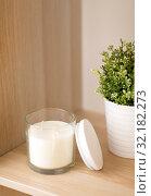 Купить «fragrance candle in glass holder on shelving», фото № 32182273, снято 12 апреля 2019 г. (c) Syda Productions / Фотобанк Лори