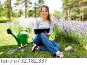 Купить «woman with tablet pc and garden tools in summer», фото № 32182337, снято 12 июля 2019 г. (c) Syda Productions / Фотобанк Лори