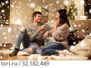 Купить «happy couple with gift box at home», фото № 32182449, снято 13 января 2018 г. (c) Syda Productions / Фотобанк Лори