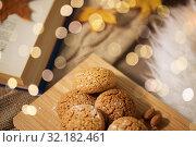 Купить «oatmeal cookies on wooden board at home», фото № 32182461, снято 15 ноября 2017 г. (c) Syda Productions / Фотобанк Лори