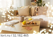 oat cookies, book, tea and lemon on table at home. Стоковое фото, фотограф Syda Productions / Фотобанк Лори