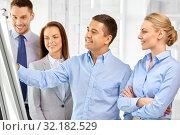 Купить «happy business team with flip chart at office», фото № 32182529, снято 5 апреля 2014 г. (c) Syda Productions / Фотобанк Лори