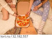 Купить «happy female friends eating pizza at home», фото № 32182557, снято 21 января 2018 г. (c) Syda Productions / Фотобанк Лори