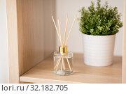 Купить «aroma reed diffuser and pot flower on wooden shelf», фото № 32182705, снято 12 апреля 2019 г. (c) Syda Productions / Фотобанк Лори