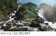 Купить «Latefoss or Latefossen waterfall consists of two separate streams flowing down. Municipality of Odda, Hordaland county, Norway. Europe», видеоролик № 32182801, снято 7 июня 2019 г. (c) Кекяляйнен Андрей / Фотобанк Лори