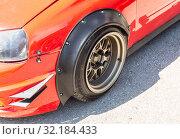 Купить «Modern tuned automotive wheel on metal disc», фото № 32184433, снято 18 мая 2019 г. (c) FotograFF / Фотобанк Лори
