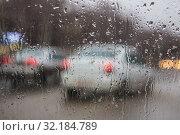 Купить «Street through rain drops», фото № 32184789, снято 15 апреля 2017 г. (c) Юрий Бизгаймер / Фотобанк Лори