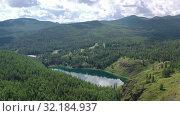 Купить «Aerial video view from drone on Altai natural landscape of Ulagan Plateau with Uchkol mountain lake. Altai, Siberia, Russia», видеоролик № 32184937, снято 24 августа 2019 г. (c) Serg Zastavkin / Фотобанк Лори